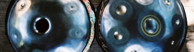 Two UFO shaped steel handpans side by side